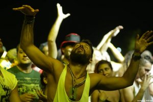 dancing ecstatic guy on a dancefloor